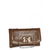 A brown coloured clutch by Aadaana for women.